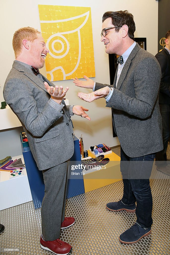 Actors Jesse Tyler Ferguson (L) and Ty Burrell attend Tie The Knot Pop-Up Store at The Beverly Center on December 5, 2013 in Los Angeles, California.