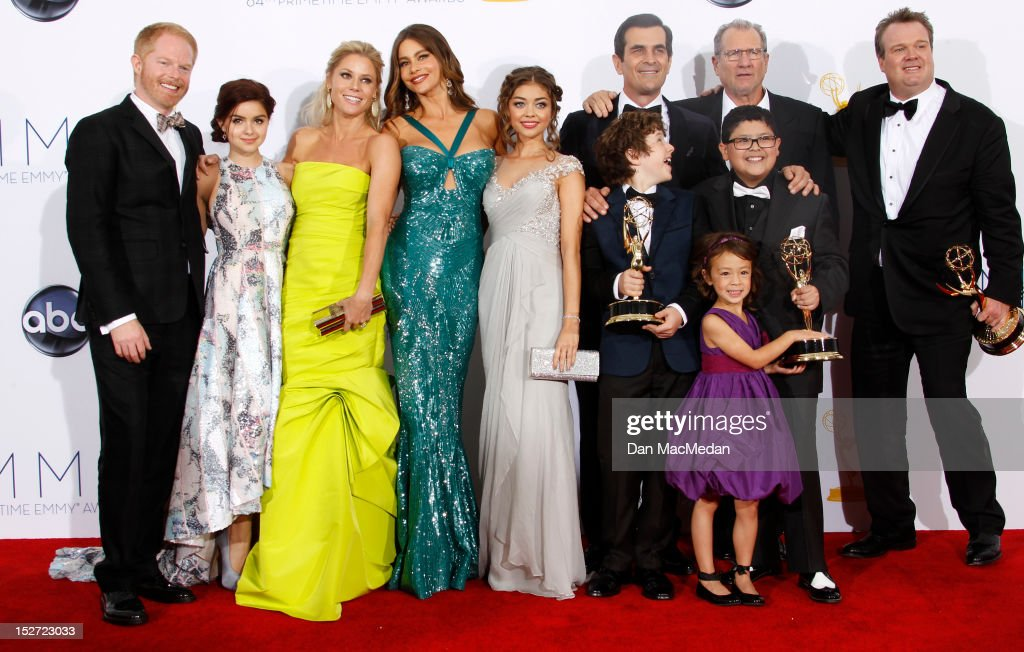 Actors Jesse Tyler Ferguson, Ariel Winter, Julie Bowen, Sofia Vergara, Sarah Hyland, Ty Burrell, Nolan Gould, Ed O'Neill, Rico Rodridgez, and Eric Stonestreet, with Aubrey Anderson-Emmons (front), pose in the press room at the 64th Primetime Emmy Awards held at Nokia Theatre L.A. Live on September 23, 2012 in Los Angeles, California.