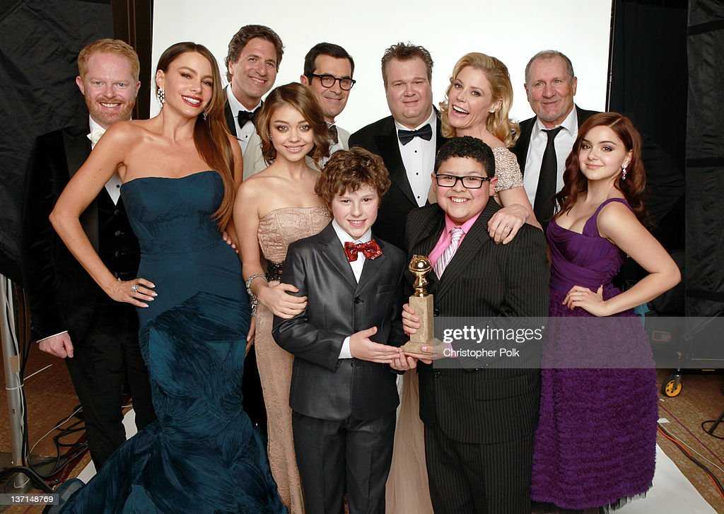 Actors Jesse Tyler Ferguson, Sofia Vergara, creator/producer Steven Levitan, actors Sarah Hyland, Ty Burrell, Nolan Gould, Eric Stonestreet, Julie Bowen, Rico Rodriguez, Ed O'Neill and Ariel Winter, winners of the Best Television Series - Musical or Comedy award for 'Modern Family' pose for a portrait backstage at the 69th Annual Golden Globe Awards held at the Beverly Hilton Hotel on January 15, 2012 in Beverly Hills, California.