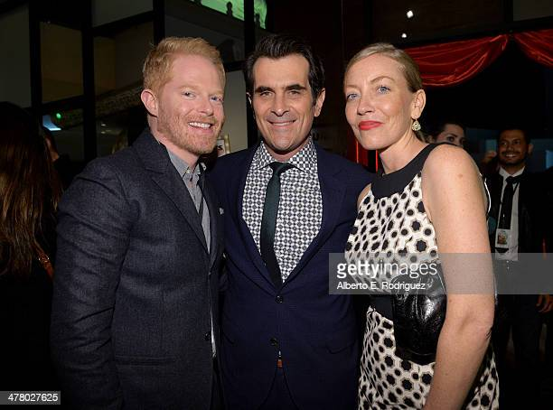 """Actors Jesse Tyler Ferguson, Ty Burrell and Holly Burrell attend the world premiere of Disney's """"Muppets Most Wanted"""" after party at The Annex on..."""