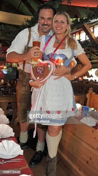 Actors Jessica Boehrs and Marcus Gruesser attend the CelebrityWiesnMeeting 2014 organised by Mainstream Media AG at the 181th Oktoberfest in Munich...