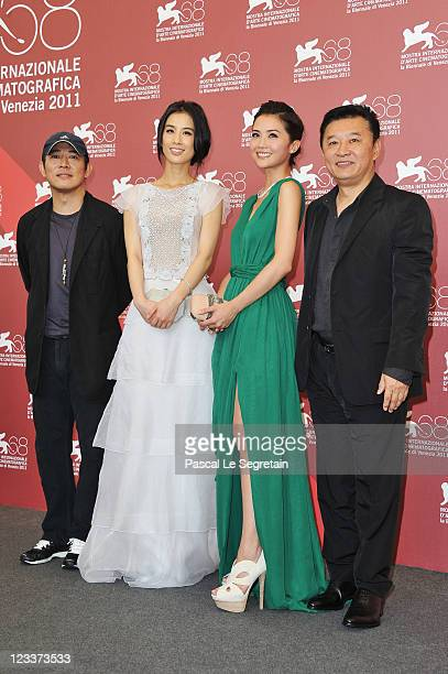 Actors Jet Li Shengyi Huang Charlene Choi and director SiuTung Ching pose at the 'The Sorcerer And The White Snake' photocall during the 68th Venice...