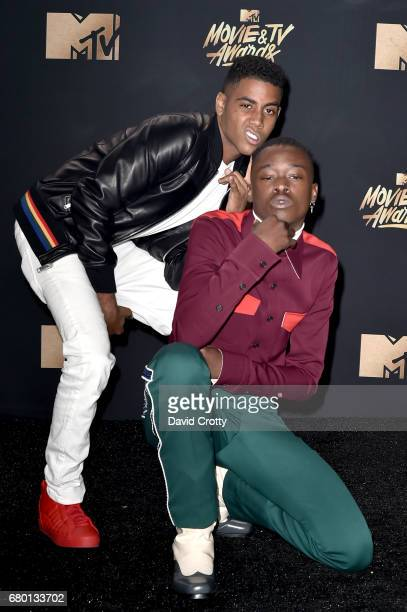 Actors Jharrel Jerome and Ashton Sanders winners of Best Kiss for 'Moonlight' pose in the press room during the 2017 MTV Movie And TV Awards at The...