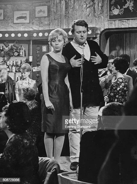 Actors Jill Browne and William Rushton stars of the television show 'New Stars and Garters' singin on stage 1965