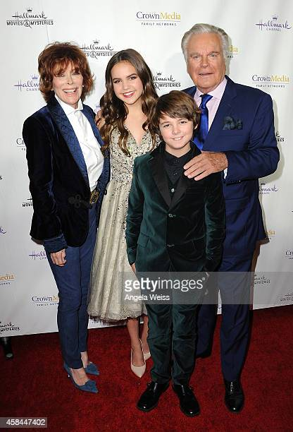 Actors Jill St. John, Bailee Madison, Max Charles and Robert Wagner arrive at Hallmark Channel's annual holiday event premiere screening of...
