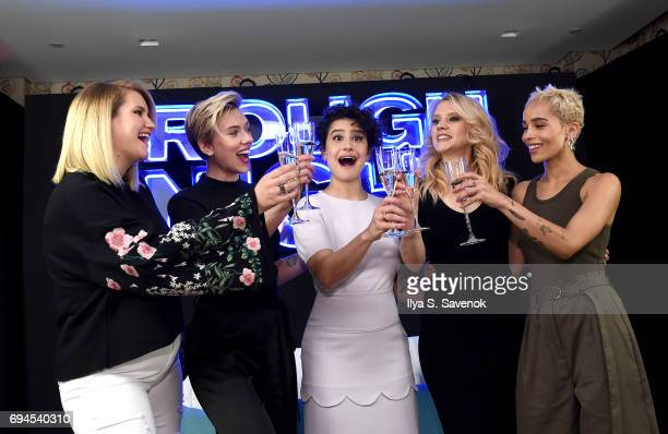 Actors Jillian Bell Scarlett Johansson Ilana Glazer Kate McKinnon and Zoe Kravitz make a toast during Rough Night Photo Call at Crosby Street Hotel...