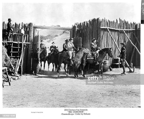 Actors Jim Brown Stuart Whitman and Richard Boone on set of the 20th Century Fox movie Rio Conchos in 1964