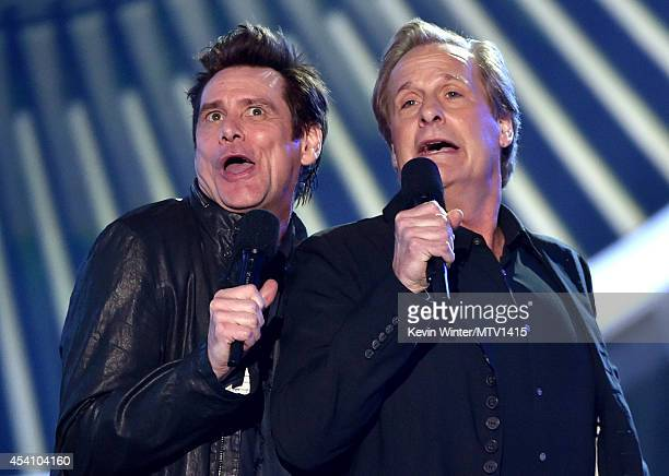 Actors Jim Carrey and Jeff Daniels speak onstage during the 2014 MTV Video Music Awards at The Forum on August 24 2014 in Inglewood California