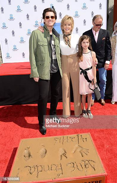 Actors Jim Carrey Jane Fonda and granddaughter Viva Vadim attend actress Jane Fonda's Handprint/Footprint Ceremony during the 2013 TCM Classic Film...