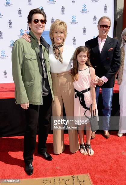 Actors Jim Carrey Jane Fonda granddaughter Viva Vadim and actor Peter Fonda attend actress Jane Fonda's Handprint/Footprint Ceremony during the 2013...