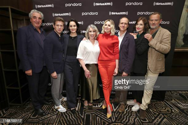 Actors Jim Carter, Allen Leech, Michelle Dockery, Phyllis Logan, Laura Carmichael, Kevin Doyle, Elizabeth McGovern and Hugh Bonneville pose for a...