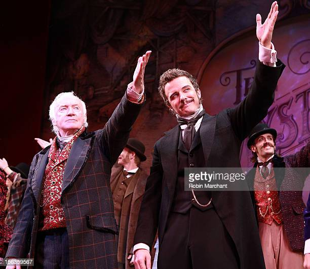 Actors Jim Norton and Will Chase come out for a curtain call during the 'The Mystery Of Edwin Drood' Broadway Opening Night at Roundabout Theatre...