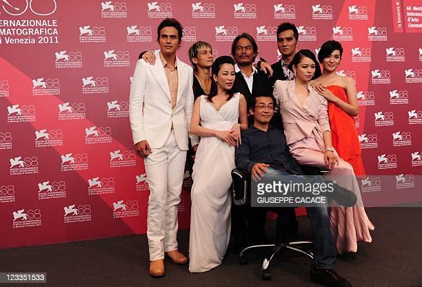 Actors Jimmy Huang Ando Masanobu Da Ching Umin Boya Landy Wen director TeSheng Wei Vivian Hsu and Lo Meiling pose during the photocall of Seediq Bale...
