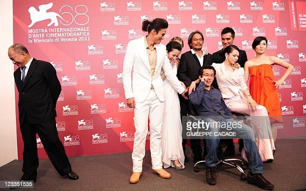Actors Jimmy Huang Ando Masanobu Da Ching Umin Boya Landy Wen director TeSheng Wei Lo Meiling and Vivian Hsu pose while producer John Woo stands by...