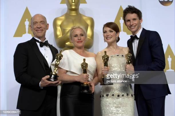 Actors JK Simmons Patricia Arquette Julianne Moore and Eddie Redmayne pose in press room of the 87th Academy Awards Oscars at Dolby Theatre in Los...