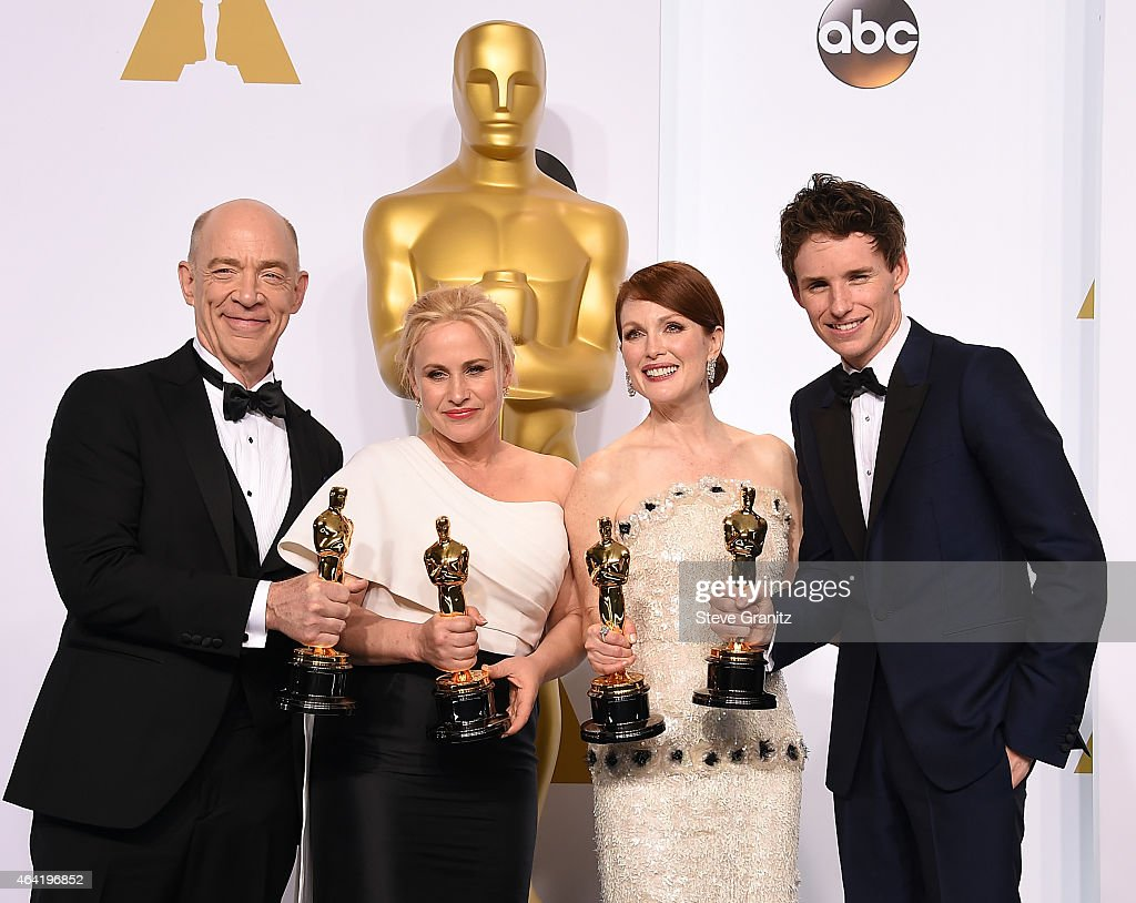 Actors J.K. Simmons, Patricia Arquette, Julianne Moore and Eddie Redmayne pose with their awards in the press room during the 87th Annual Academy Awards at Loews Hollywood Hotel on February 22, 2015 in Hollywood, California.