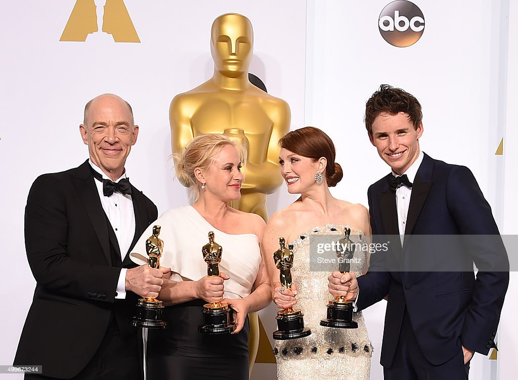 Actors J.K. Simmons, Patricia Arquette, Julianne Moore and Eddie Redmayne pose in the press room during the 87th Annual Academy Awards at Loews Hollywood Hotel on February 22, 2015 in Hollywood, California.