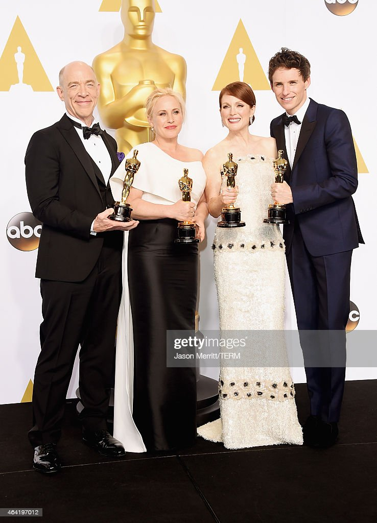 Actors J.K. Simmons, winner of the award for best actor in a supporting role for the film 'Whiplash', Patricia Arquette winner of the award for Best Actress in a Supporting Role for 'Boyhood', Julianne Moore winner for the Best Actress in a Leading Role Award for 'Still Alice', and Eddie Redmayne winner of the Best Actor in a Leading Role Award for 'The Theory of Everything' poses in the press room during the 87th Annual Academy Awards at Loews Hollywood Hotel on February 22, 2015 in Hollywood, California.