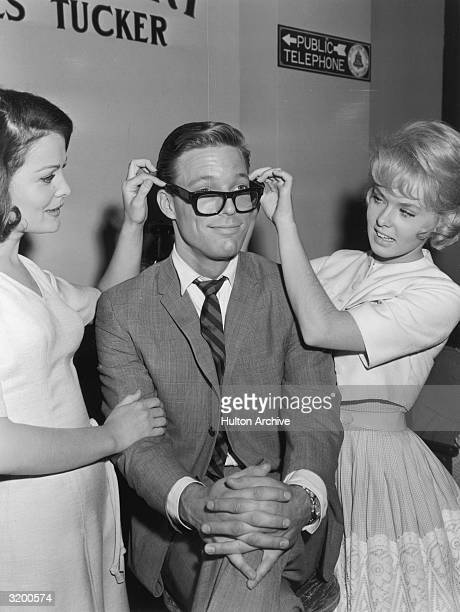 Actors Joan Blackman and Joey Heatherton adjust American actor Richard Chamberlain's eyeglasses as they promote director Boris Sagal's film 'Twilight...