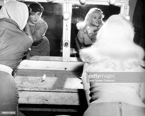 Actors Joan Collins as Alice Chicoy and Jayne Mansfield as Camille Oakes in the film 'The Wayward Bus', 1957.