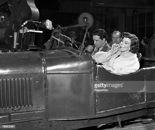 Actors Joan Rice and John Gregson sit in a car on the set of the Film 'Tomorow is Sunday', The film also starred Joan Rice, Sidney Tafler and Cyril...