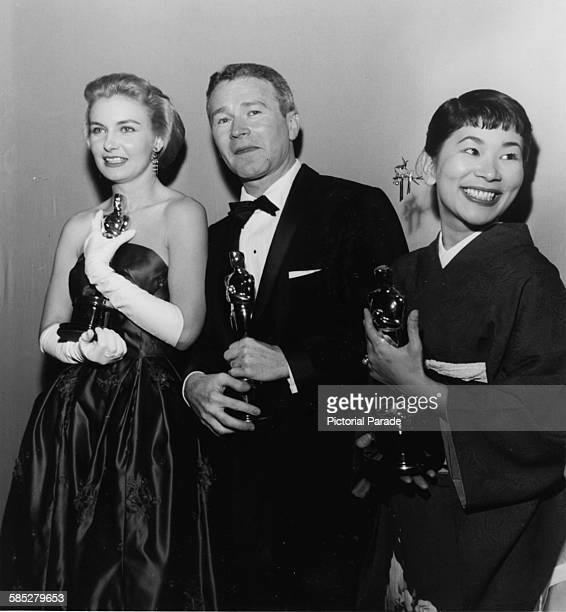 Actors Joanne Woodward Red Buttons and Miyoshi Umeki holding their Oscars at the 30th Academy Awards Los Angeles March 26th 1958
