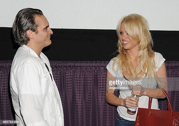 Actors Joaquin Phoenix and Pamela Anderson attend the screening of Unity directed by Shaun Monson at Universal CityWalk on August 12 2015 in...