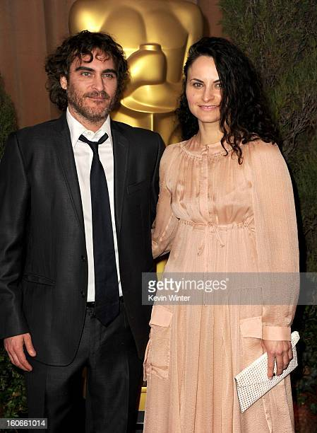 Actors Joaquin Phoenix and Rain Phoenix attend the 85th Academy Awards Nominations Luncheon at The Beverly Hilton Hotel on February 4 2013 in Beverly...