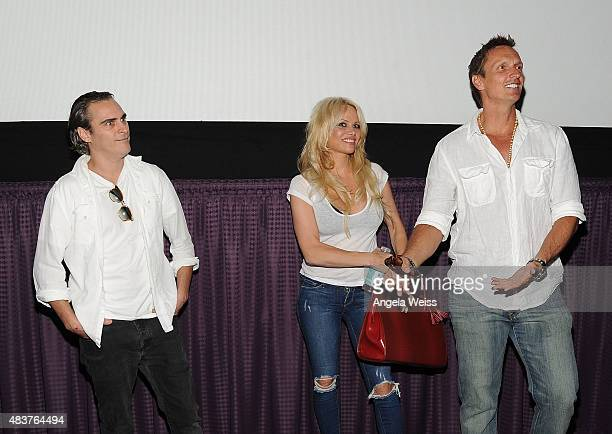 Actors Joaquin Phoenix Pamela Anderson and director Shaun Monson attend the screening of Unity directed by Shaun Monson at Universal CityWalk on...