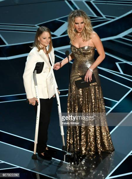 Actors Jodie Foster and Jennifer Lawrence speak onstage during the 90th Annual Academy Awards at the Dolby Theatre at Hollywood Highland Center on...
