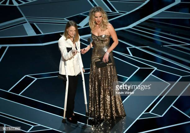 Actors Jodie Foster and Jennifer Lawrence speak onstage during the 90th Annual Academy Awards at the Dolby Theatre at Hollywood & Highland Center on...