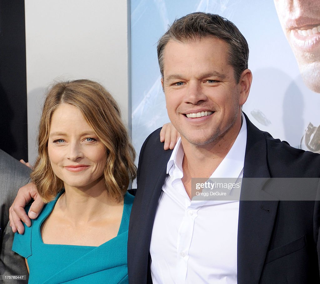 Actors Jodie Foster and Matt Damon arrive at the Los Angeles premiere of 'Elysium' at Regency Village Theatre on August 7, 2013 in Westwood, California.