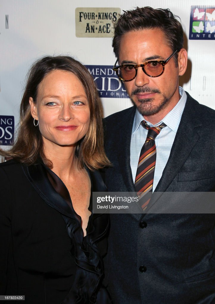 Actors Jodie Foster (L) and Robert Downey Jr. attend Mending Kids International's 'Four Kings & An Ace' Celebrity Poker Tournament at The London Hotel on December 1, 2012 in West Hollywood, California.