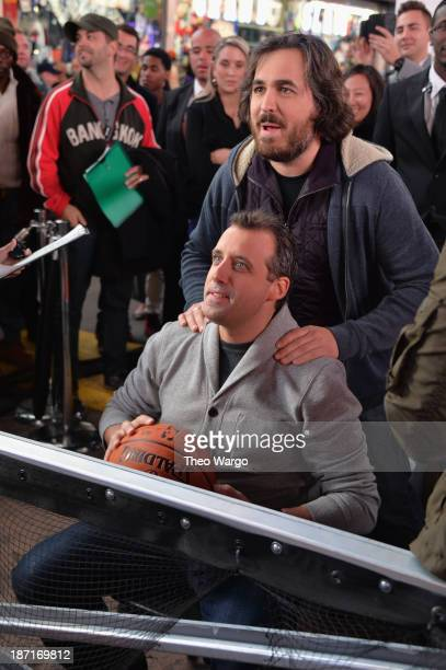 Actors Joe Gatto and Brian Quinn participate at the Guinness World Records Unleashed Arena in Times Square on November 6 2013 in New York City...