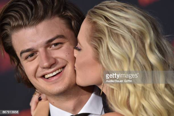 Actors Joe Keery and Maika Monroe arrive at the premiere of Netflix's 'Stranger Things' Season 2 at Regency Bruin Theatre on October 26 2017 in Los...