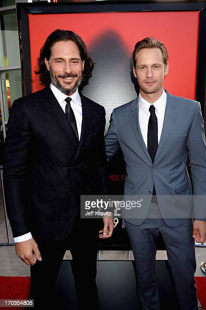 Actors Joe Manganiello and Alexander Skarsgard attend HBO's True Blood season 6 premiere at ArcLight Cinemas Cinerama Dome on June 11 2013 in...