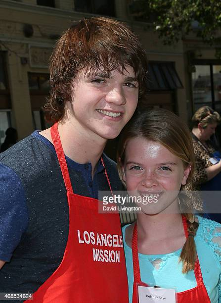 Actors Joel Courtney and Delaney Raye attend the Los Angeles Mission Easter event at the Los Angeles Mission on April 3, 2015 in Los Angeles,...