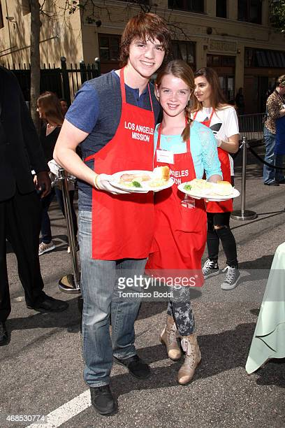 Actors Joel Courtney and Delaney Raye attends the Los Angeles Mission Easter Event held at the Los Angeles Mission on April 3, 2015 in Los Angeles,...