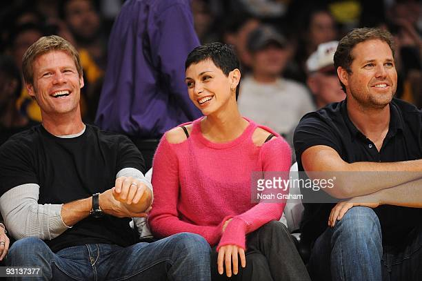 Actors Joel Gretsch Morena Baccarin and David Denman sit courtside during the game between the Memphis Grizzlies and the Los Angeles Lakers on...