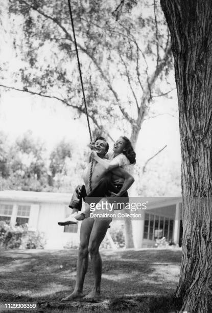Actors Joel McCrea and Frances Dee pose for a portrait playing on a string in circa 1950
