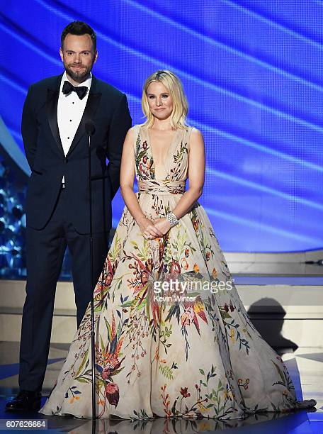 Actors Joel McHale and Kristen Bell speak onstage during the 68th Annual Primetime Emmy Awards at Microsoft Theater on September 18 2016 in Los...