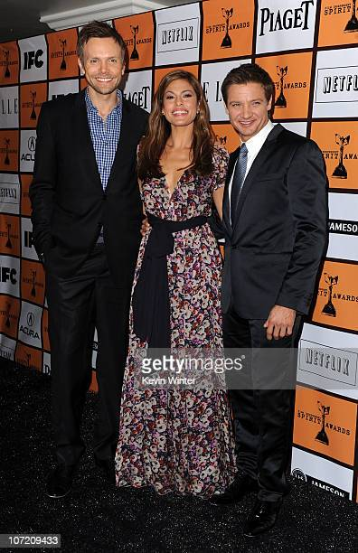 Actors Joel McHale Eva Mendes and Jeremy Renner poses onstage during the 2011 Film Independent Spirit Award nominations press conference at The...