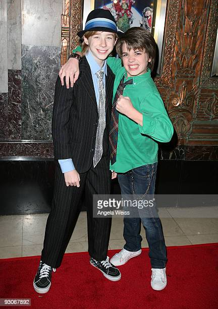 Actors Joey Luthman and Brandon Tyler Russell attend the Los Angeles premiere of Dr Seuss' 'How The Grinch Stole Christmas' at the Pantages Theatre...