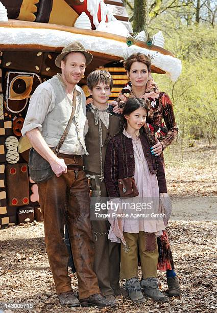 Actors Johann von Buelow as father Friedrich Heine as Haensel Anja Kling as the herbal fairy and Mila Boehning as Gretel pose during a ARD set visit...