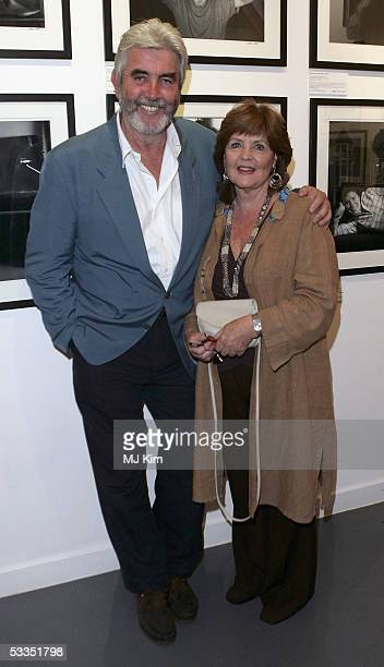 Actors John Alderton and his wife Pauline Collins attend at the private view for Off Stage The RADA Centenary Portraits photographer Cambridge...