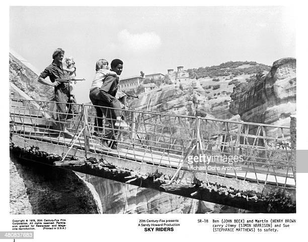 Actors John Beck Henry Brown Simon Harrison and actress Stephany Mathews in a scene from the movie Sky Riders circa 1976