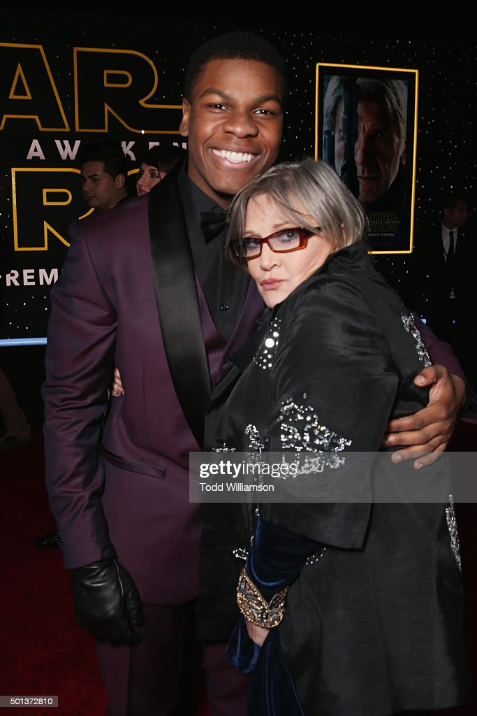 Actors John Boyega (L) and Carrie Fisher attend the Premiere of Walt Disney Pictures and Lucasfilm's 'Star Wars: The Force Awakens' on December 14, 2015 in Hollywood, California.
