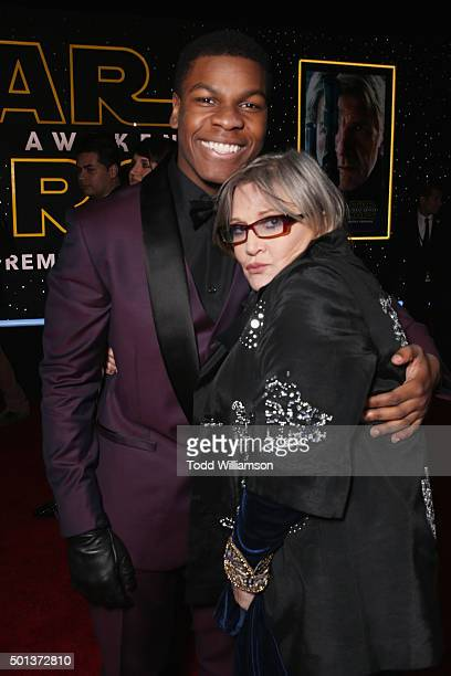 Actors John Boyega and Carrie Fisher attend the Premiere of Walt Disney Pictures and Lucasfilm's 'Star Wars The Force Awakens' on December 14 2015 in...