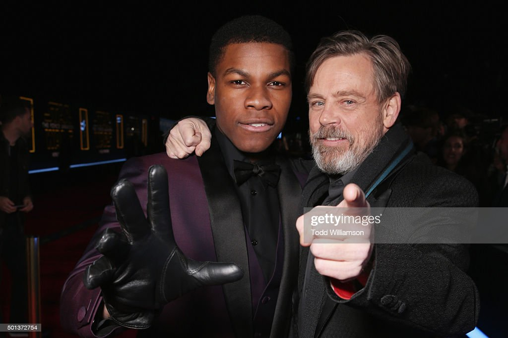 Actors John Boyega (L) and Mark Hamill attend the Premiere of Walt Disney Pictures and Lucasfilm's 'Star Wars: The Force Awakens' on December 14, 2015 in Hollywood, California.