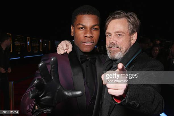 Actors John Boyega and Mark Hamill attend the Premiere of Walt Disney Pictures and Lucasfilm's Star Wars The Force Awakens on December 14 2015 in...